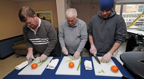 Picture of three Veteran's cooking